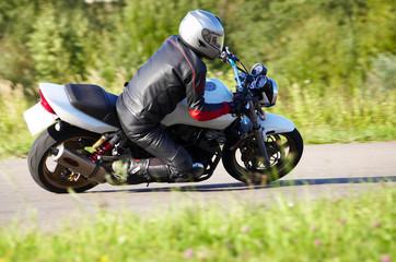 Motorcyclist rides turn.