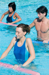 Fitness exercise in water swimming pool