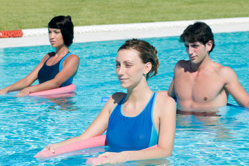 Active people doing aqua gym in a pool