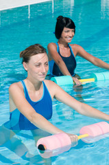 Water exercising with aqua dumbbell