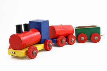 Colorful miniature wooden toy train on white background