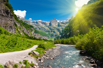 Idyllic alpine valley in sun rays. Sixt Fer a Cheval, France.