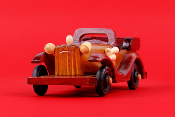 A toy car made of wood