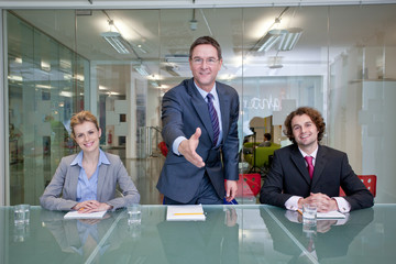 Friendly businesspeople in conference room