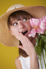 surprised woman in summer hat