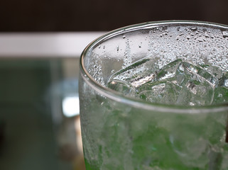 glasses of ice with green liquid