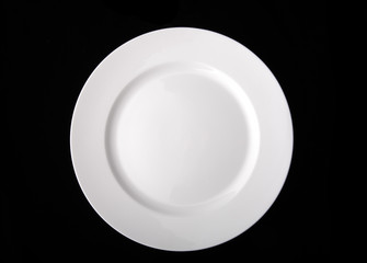 blank white dinner plate isolated on the black background with c