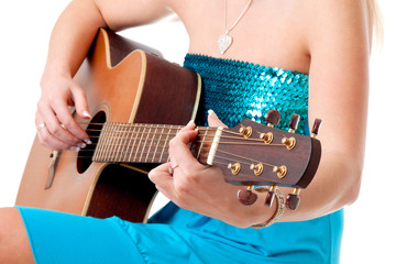 Closeup of a woman hands with acoustic guitar