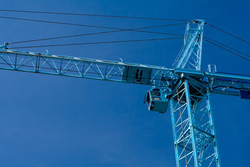 Construction Crane Isolated Against Blue Sky