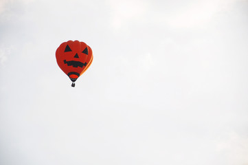 Hot Air Pumpklin Balloon against sky background