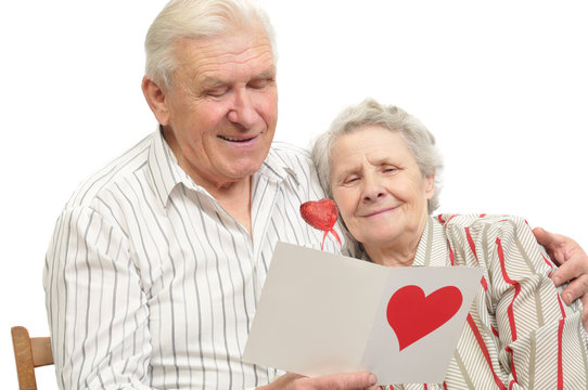 happy old couple with post-card