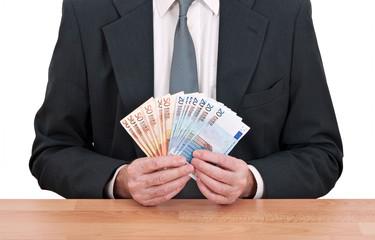 Businessman holding Euros cash
