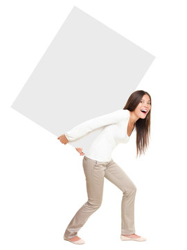 Woman showing / lifting heavy sign