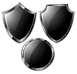 Set of black steel shields - isolated on white