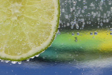 Colorful glass with lime and bubbles background