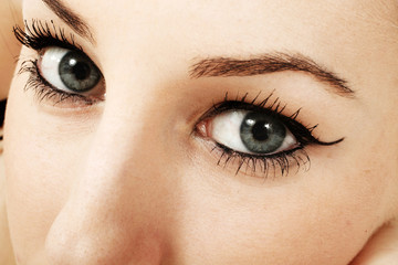 Close-up image of a woman's beautiful blue eyes