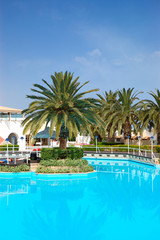 Swimming pool and palm trees at the luxury hotel, Crete, Greece