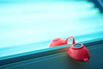 Tanning Goggles Resting on Tanning Bed