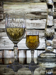 Wine for two on rustic wood wall background