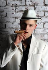 Mafia man with cigar. Gangster