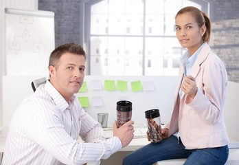 Colleagues during coffee break in office