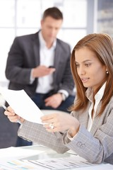 Young female working with papers in office