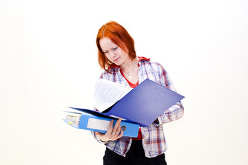 Redhead young woman with a folder