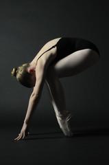 Ballet dancer posing in artistic style