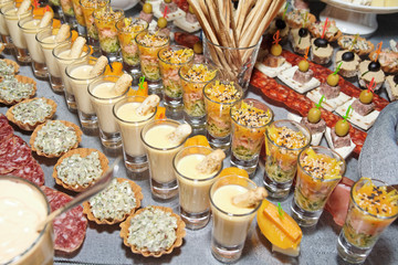 Snacks and sweets on banquet table
