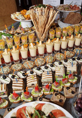 Great number of snacks on banquet table