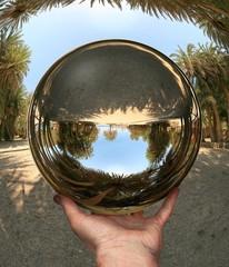 Glass sphere in hand. Vai. Crete