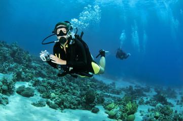 female scuba diver with camera