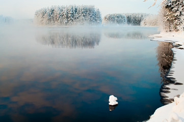 Unfrozen lake in the winter forests of Karelia, Russia