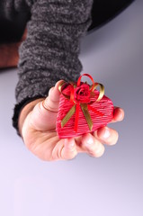 hand holding heart shaped gift