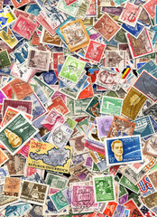 Large pile of postage stamps