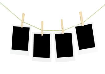Photos and wooden clothespins isolated on white