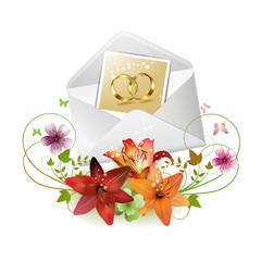 Envelope with photo of two wedding ring and decorated flowers