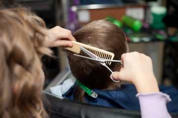 little funny children play in the barbershop