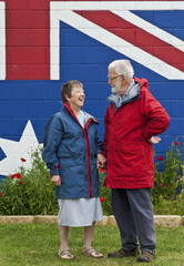 Australian couple in eighties wearing red and blue jackets