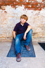 cute boy in the cellar with brick background