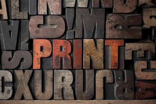 The word 'PRINT' spelled out in very old letterpress blocks.