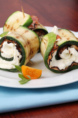 Zucchini rolls with pepper crusted bacon and cheese