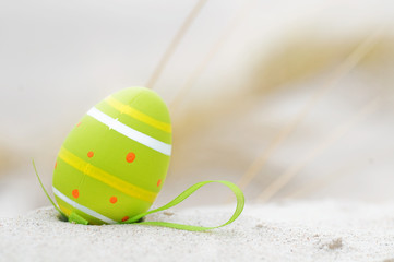 Easter decorated egg on sand