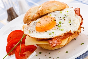 Breakfast - fried egg with bacon and cheese