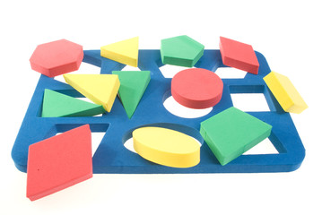 Children's developing game with color geometric shapes
