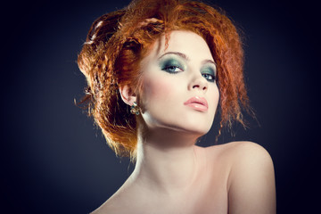 Beautiful redhead woman with perfect hair style and makeup.