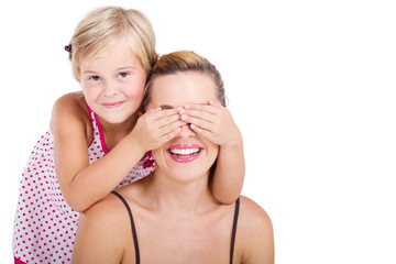playful daughter covering mothers eyes