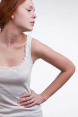 girl tensely holding her waist