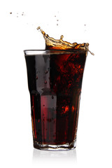 Cola splashing out of glass