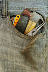 repairman jean with tool in pocket